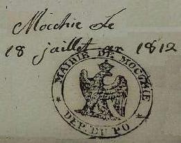 Timbro del Comune di Mocchie in uso sui documenti nel periodo 1800/1814 quando il territorio del ducato si Savoia era stato occupato dai francesi, suddiviso in sei dipartimenti e incorporato nel territorio francese